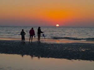 Three shellers at sunrise on Sanibel