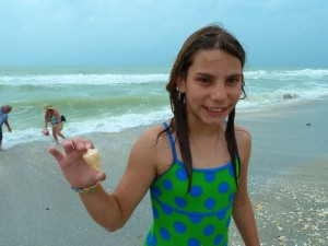 girl with cone seashell