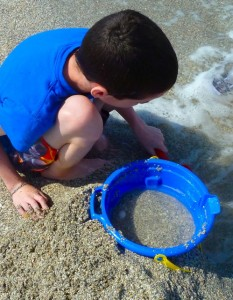 boy and sand bucket