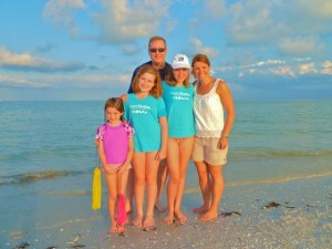 Family on Sanibel lighthouse beach