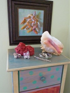 Display of seashells with painting