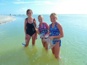Kim, Hannah and Abby with sand dollars