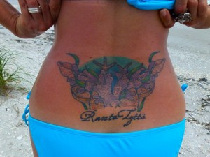 Beach girl tattoo in Finnish