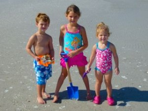 kids on beach with seashells