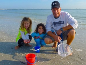 dad with girls on sanibel beach