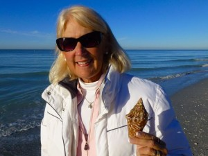 jane with juvenile milk conch sanibel beach