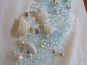 seashells and sea glass embellish dress