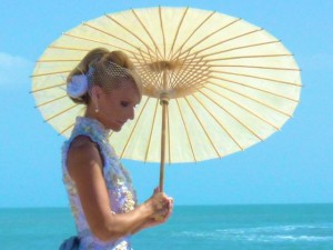 beach bride with umbrella