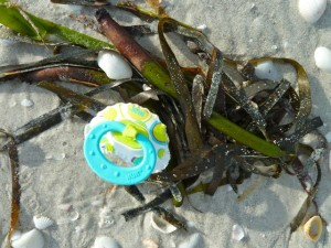 pacifier on beach