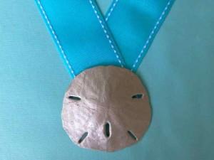 platinum sand dollar medal