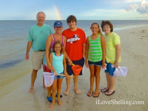 family Sanibel Island beach with rainbow