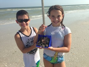 kids with sand dollars