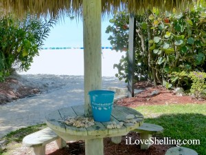beach resort tiki hut with shells