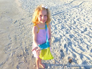 sophia shows a seashell she found on the beach of Captiva