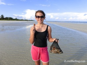 Michayla from Pensacola finds sea shells on Sanibel Island Florida