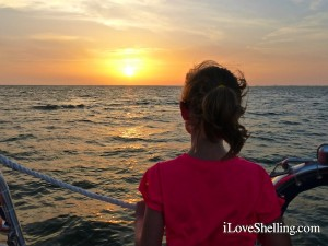 watching sunset on shelling boat