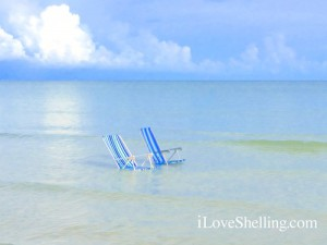 Beach chairs at low tide Sanibel