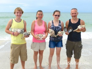 Cameron, Mary, Lauren and Gary with large shells found in Sanibel