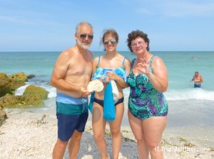 Keith, Hannah and Linda show sea shells found on Captiva