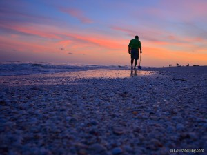 Low tide Beach combing at sunset on Sanibel Island