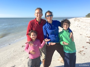 family with seashells on Sanibel beach