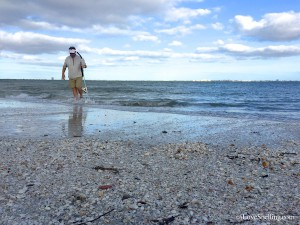 Clark scooping shells at Sanibel Lighthouse beach