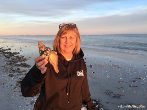Lynn MO finds a house conch on Sanibel
