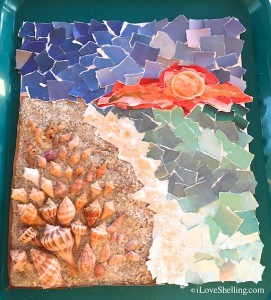 Seashell and paper mosaic display
