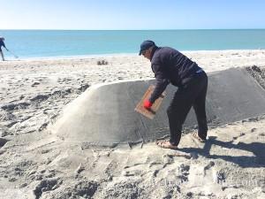Robert smoothing Captiva sand sculpture