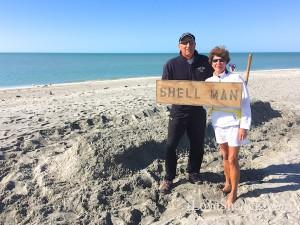 Shell Man building beach art