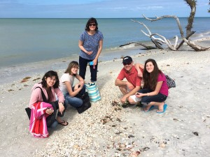 Family shelling on Cayo Costa Florida beach