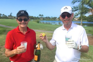 Clark Rambo hole in one celebrates with John