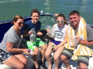 Marlene, Max, Emily, Ryan on shelling boat