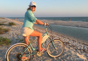Pam Rambo biking Bowmans Beach Sanibel aqua
