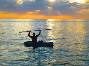 sanibel kayaker celebrating sunset