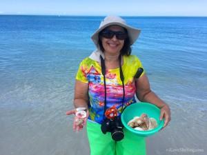 Seminole Bea collects shells on Florida island