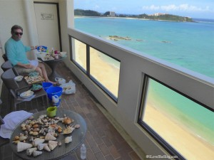 Cleaning organizing shells on vacation in Okinawa Japan