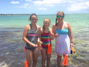 Kelby, Kiley and Sadie from Wyoming collect shells in Florida