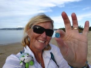 Happy Pam finds an aqua sea marble beach combing Okinawa Japan