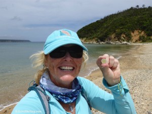 Happy finding seaglass marble in Okinawa Japan beach combing