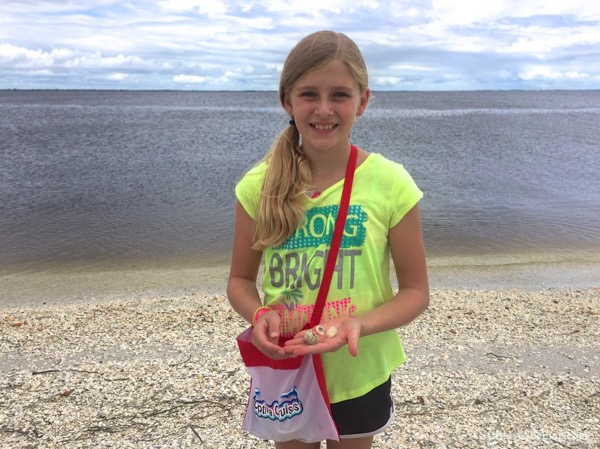 Lexi Indiana receives gifts from the sea on the beach