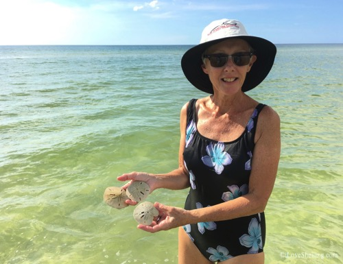 Dale Ft Myers with sand dollars on Cayo costa