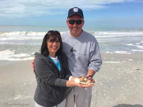 happy couple finding shells